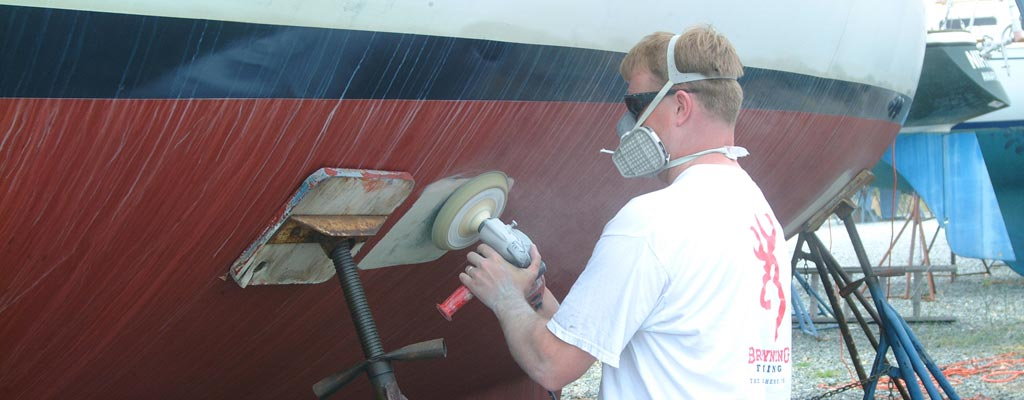 a man buffing the gel coat of a boat