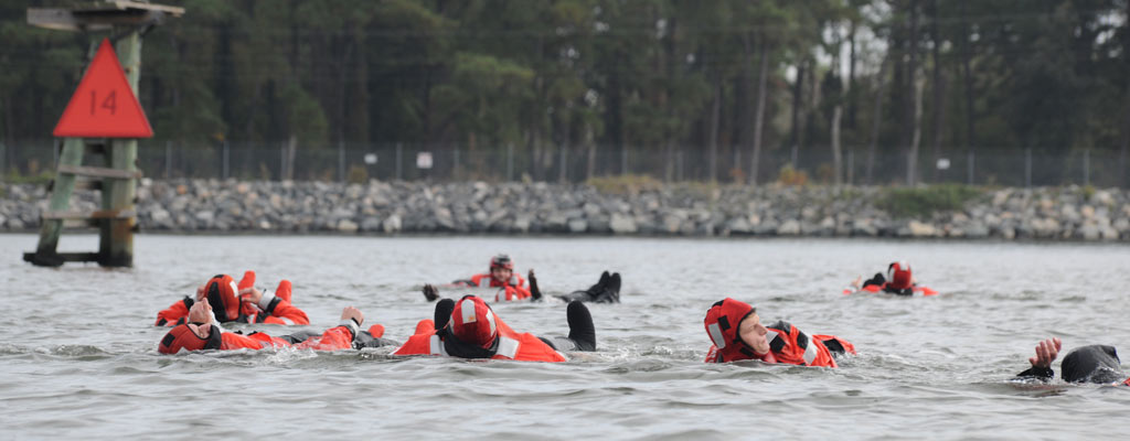 seven sailors splash and swim, sharpening survival skills