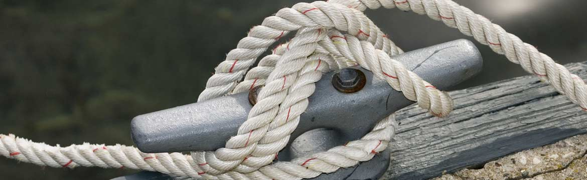 A dock cleat with some rope wrapped around it