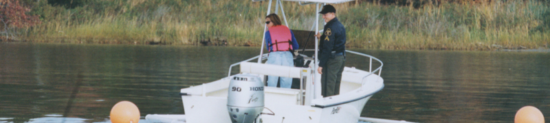 A vessel operator backs the boat under the supervision of a law enforcement officer.
