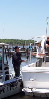 A vessel operator stopped and questioned by a marine patrol officer.