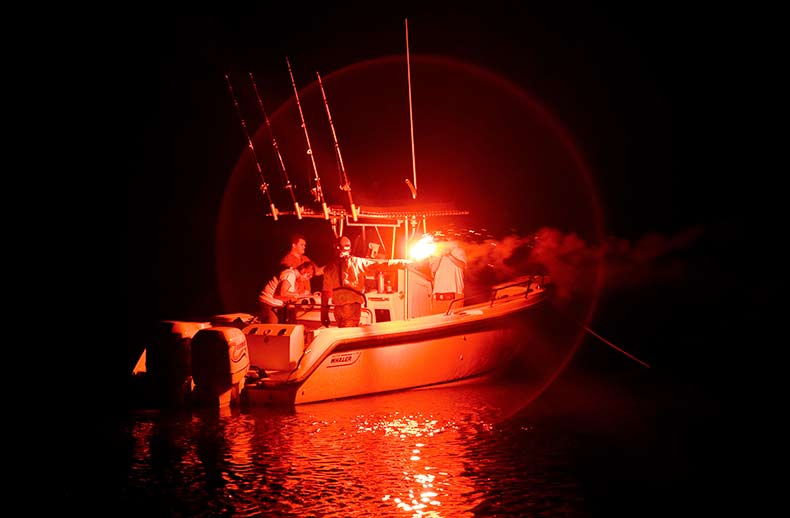 A center console is illuminated by a red flare.