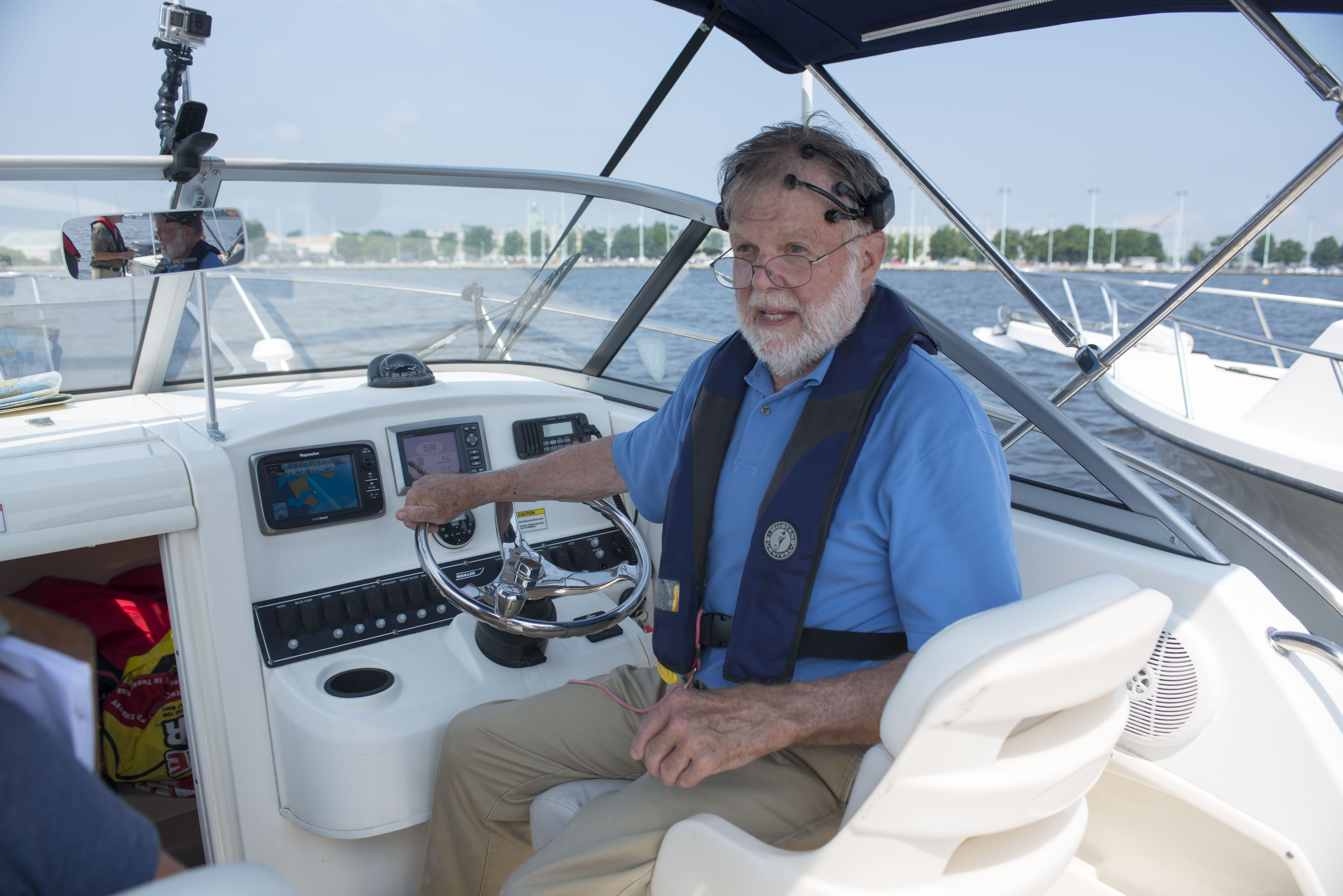 John Page Williams at the helm