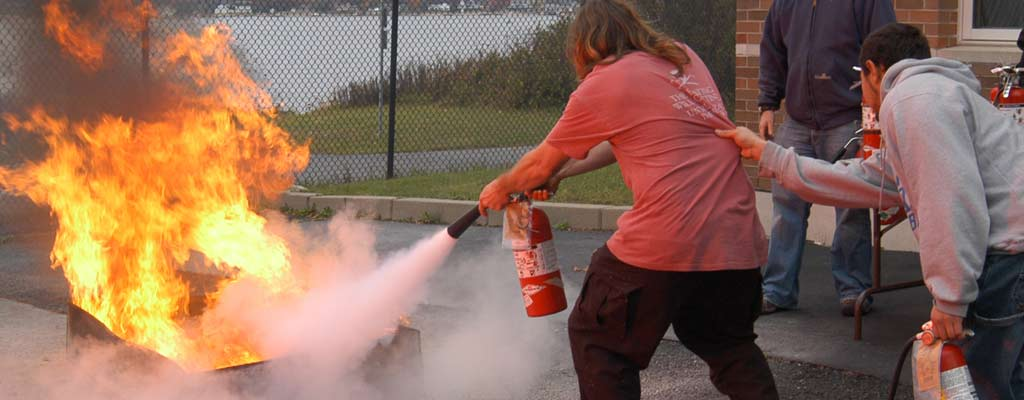 a man puts out a fire with an extinguisher