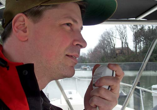 man using a vhf radio